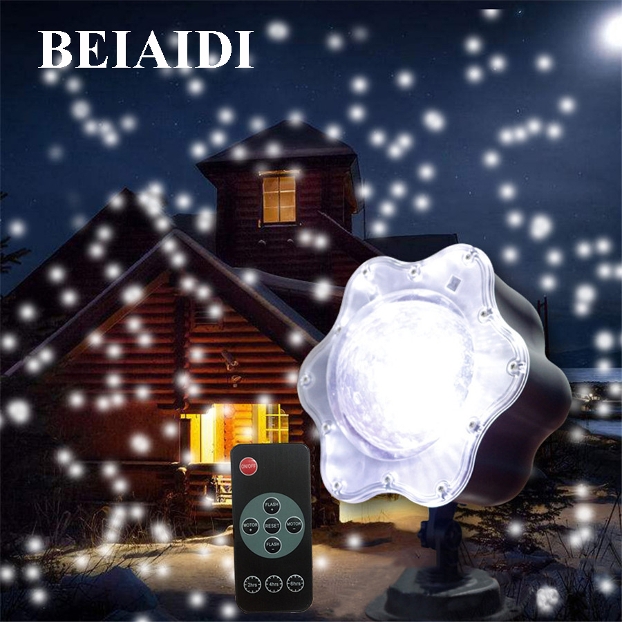 цена BEIAIDI Snowfall Christmas Laser Projector Light Outdoor Star Snowflakes Outdoor LED Stage Lamp Wedding Landscape Garden Light онлайн в 2017 году