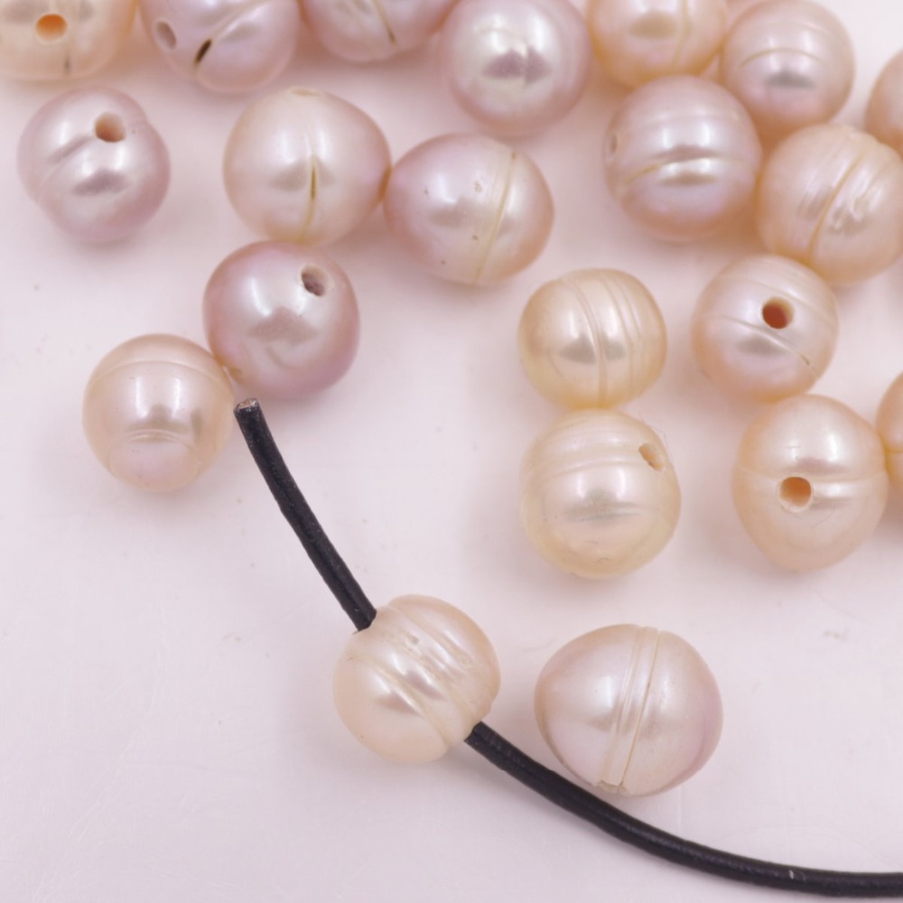 Купить с кэшбэком 100PCS 10-11mm Oval Natural Pink Purple Growth Pearl 1.5mm Full Hole Loose Beads