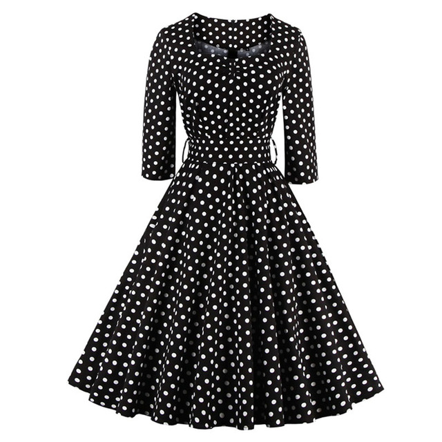 Robe noire a gros pois blancs