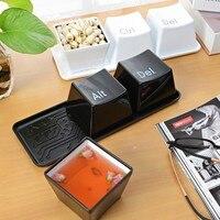 สร้างสรรค์tazaสีดำและสีขาวแป้นพิมพ์ขนมขบ