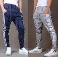 2016 NUEVOS Hombres Pantalones Casuales Elástico de algodón Para Hombre de Fitness JADEO y OROS Entrenamiento Pantalones flacos, Pantalones de Chándal Basculador Pantalones