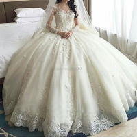 Dubai Crystal Flowers Ball Gown Wedding Dresses 2019 Long Sleeve Muslim Wedding Gowns Cathedral Train Lace Appliques Bride Dress