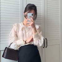 A undertakes to South Korea ins sweet double ruffled large female jacket lapel long sleeve shirt to the harness