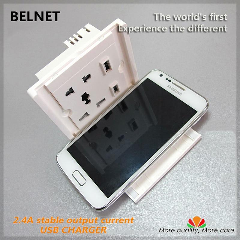 Världens första dubbla USB-vägguttag med mobiltelefonhållare 2.4A - Reservdelar och tillbehör för mobiltelefoner - Foto 1