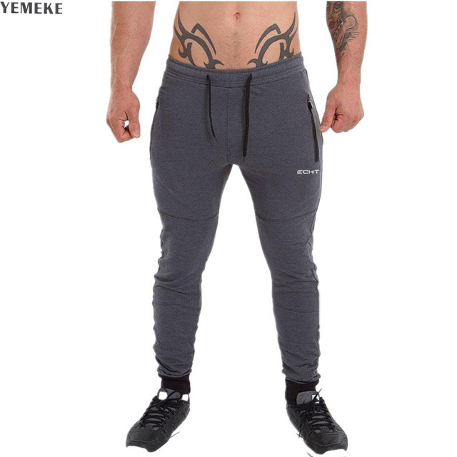 dfc29b68a346 YEMEKE New men sweatpants Zipper pocket stylish embellished trousers slim  fit pants men casual Black gray joggers male pants