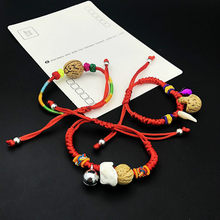 1pcs sell Baby The Newborn Cuff Bracelets The Dog Tooth Peach Pit Bracelets The Bell Red Rope Hand Catenary(China)