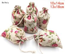 100pcs/lot Christmas Rose printing Bag Cotton Linen Gift Bags Party Favor Gift Packaging Bags Drawstring Pouch Wedding supplies(China)
