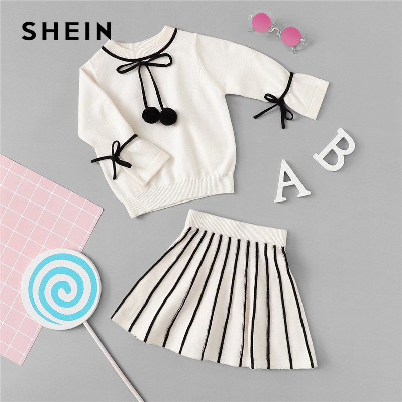 SHEIN Kiddie White Pom Pom Tied Knit Top And Flare Skirt Two Piece Girls Clothing Set 2019 Long Sleeve Elegant Kids Girl Sets halloween white skull kindergarten princess grace plain red cotton twin bow top rwb star satin trim skirt girls outfit set nb 8y