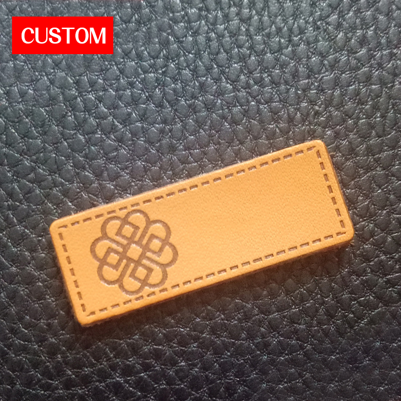 customized metal PU leather name labels embossed sewing on clothes private label branding clothing leather labels