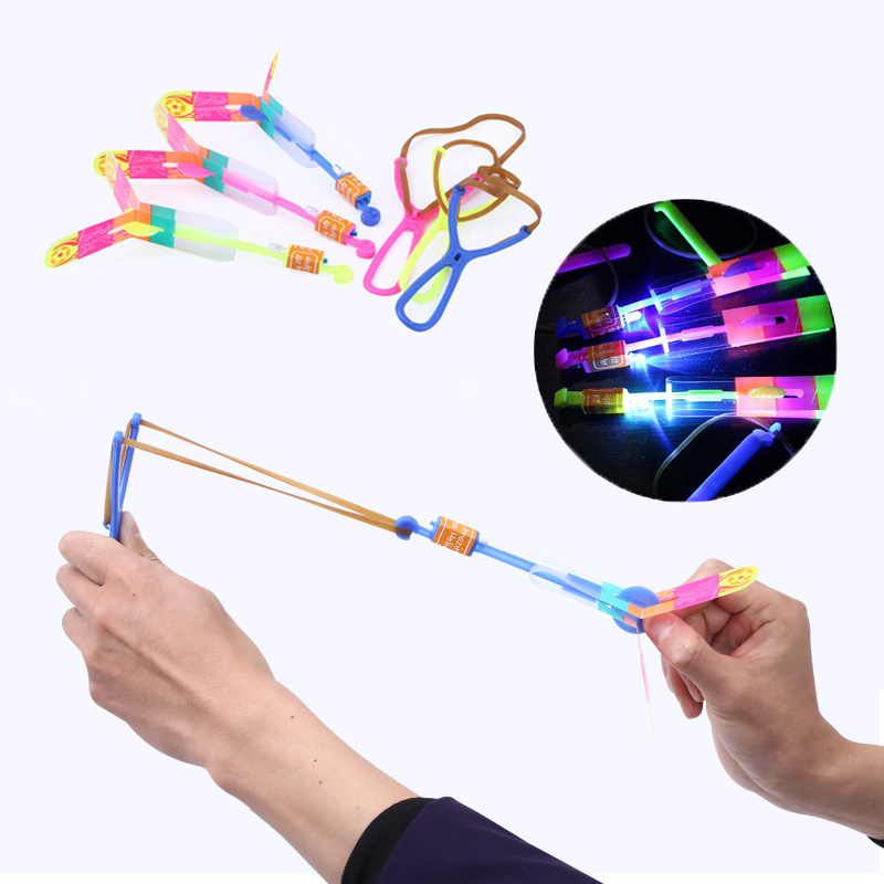 1pc Led Light-up Flashing Slingshot Helicopter Rotating Flying Toys For Children Birthday Kids Boys Outdoor Game