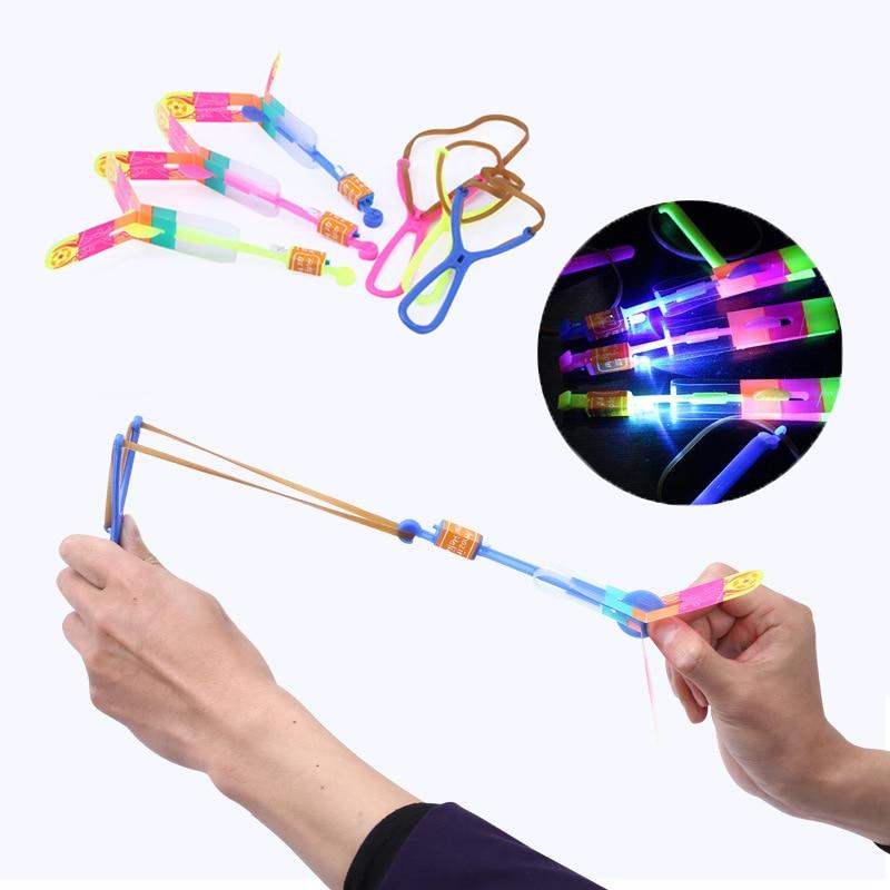 1pc Led Light-up Flashing Slingshot Helicopter Rotating Flying Toys For Children Birthday Kids Boys Outdoor Game