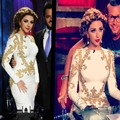 In 2016 selling this dress neckline nail bead decals long-sleeved white tuxedo mermaid Myriam fares celebrity dress floor length