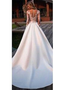 Image 3 - Brilliant Matte Satin Jewel Neckline Bridal Gowns A line Long Sleeves Wedding Dresses With Lace Appliques & Belt & Pockets