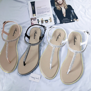 цена на Koovan Women's Shoes Summer New Rhinestone Flat Shoes Clip T-type Strap Roman Shoes Low Flat Sandals Women Plastic Sandals Beach