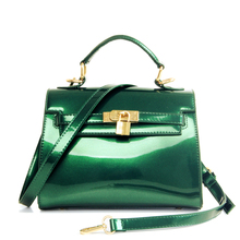 2016ฤดูร้อนมาใหม่ผู้หญิงหนังสิทธิบัตรถุงเจลลี่กระเป๋ากันน้ำบีชมินิตารางกระเป๋าc rossbodyกระเป๋าพนัง