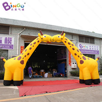 Customized 8X4.2 meters inflatable giraffe arch / yellow giraffe arch inflatable with blower toys