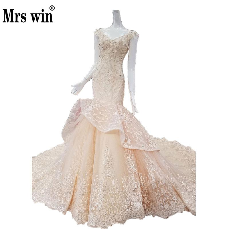 Amazing Light Champagne Mermaid Wedding Dress Tiered Ruffles Skirt Sweep Train Embroidery Luxury Bridal Gowns 2018 New Arrival C