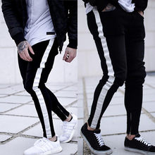 Men denim ripped hole Jeans side striped line Jeans Fashion Hip hop Skinny pencil Jeans For Men stretch ankle zipper black jeans(China)