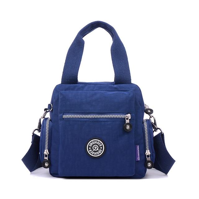 New JINQIAOER Brands Women Shoulder Bags Special offer Mother  Soft  Waterproof Nylon Quality Style Monkey Handbag Tote bolsa bebd6e539f
