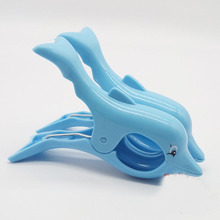 цена на 2PCS Stronging Plastic Cute Dolphin Clips Beach Towel Clamp To prevent the wind Clamp Clothes Pegs Drying Racks Retaining Clip