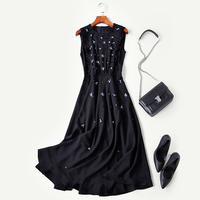 New high end boutique Hepburn spring wind black dress sleeveless nail bead cultivate morality show thin dress