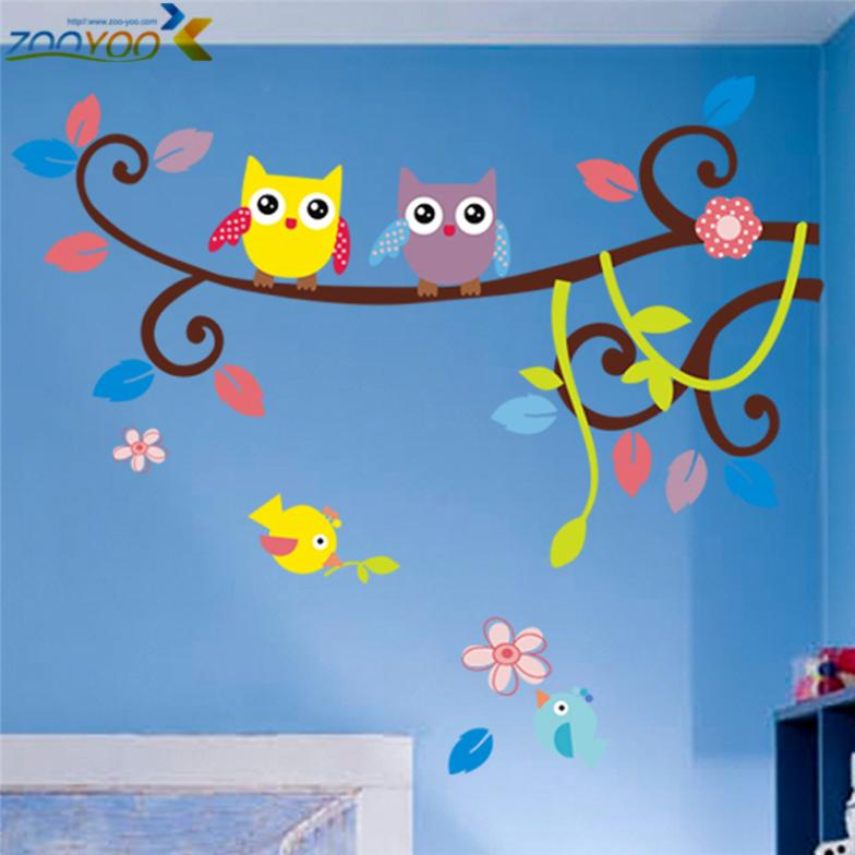 wise owls on colorful tree wall...
