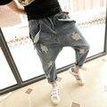 Agujero de la personalidad de talla grande harem pantalones de baja altura pantalones pitillo colgando entrepierna pantalones