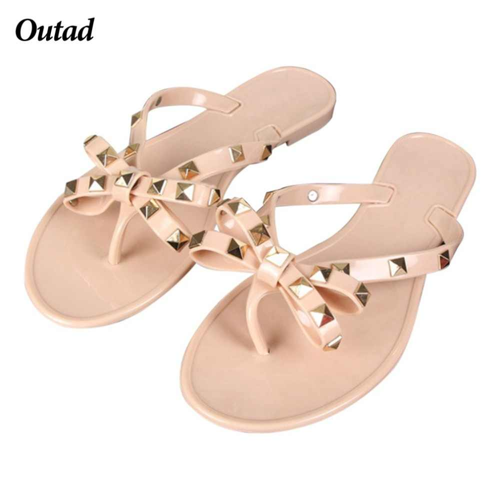 b6fccb0c9 OUTAD Fashion Woman Flip Flops Summer Beach Rivets Bow flat Plastic Sandals  Jelly Shoes Sandals For