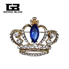 GrandBling Fine Jewelry Gold Tone Crown Brooch with Royal Blue Crystal