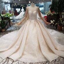 فساتين زفاف فاخرة بأكمام طويلة براقة 2020 فساتين عروس مثيرة مطرزة ومزينة بالخرز الراقية طراز HX0180 مصنوعة حسب الطلب