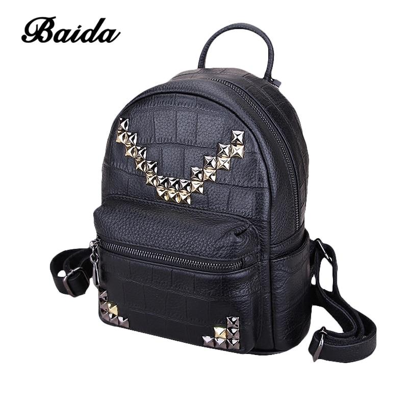 купить Fashion Women Backpacks Women's Genuine Leather Rivet Backpacks Girl School Bag High Quality Ladies Bags Designer Women Backpack по цене 5583.27 рублей