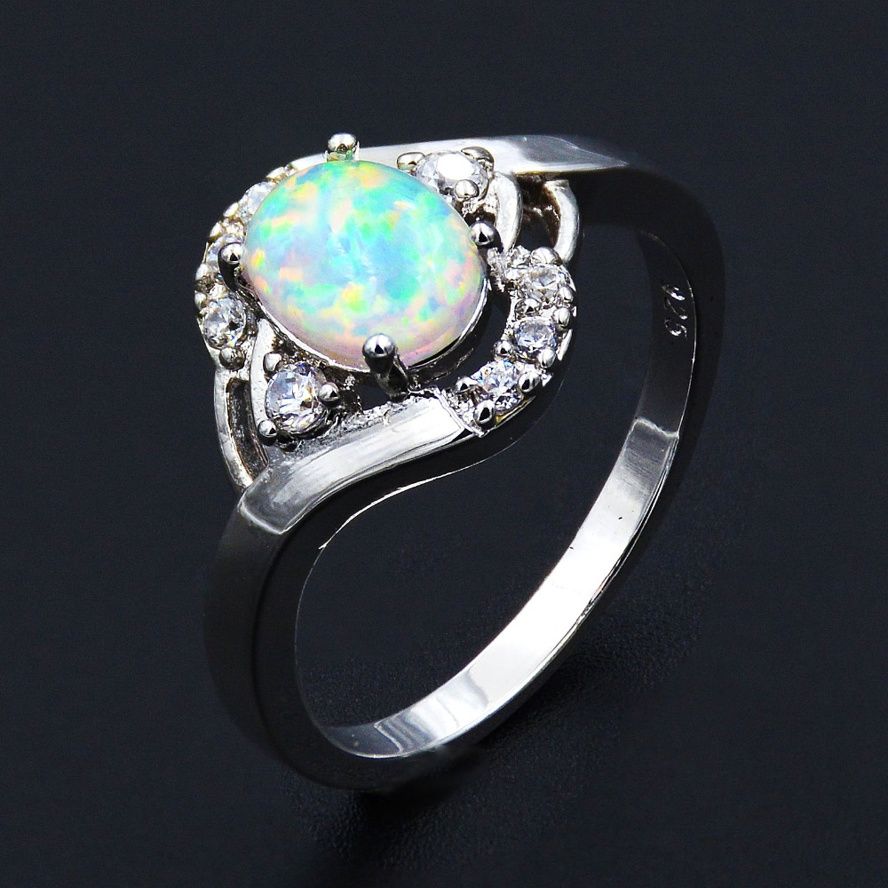 Lady's Elegant White Fire Opal Ring With Cubic Zirconia-in