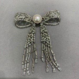 Image 2 - 11 12MM natural fresh water pearl brooch copper with cubic zircon bowknot brooch pins tassels classic fashion women jewelry