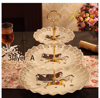 European style afternoon tea tray. Three layers. The two layers. Fruit bowl cake stand. Ceramic double fruit bowl