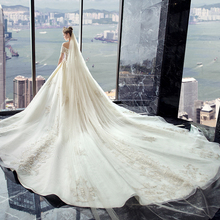 Wedding dress 2019 new bride dress word shoulder trailing luxury wedding Sen star star Hepburn out of the main wedding dress kimberly cates the wedding dress