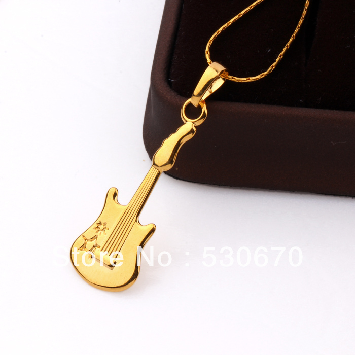 Free shipping charming 1 pc genuine 24k gold filled lovely shiny free shipping charming 1 pc genuine 24k gold filled lovely shiny guitar pendant for christmas gifts in pendants from jewelry accessories on aliexpress aloadofball Choice Image