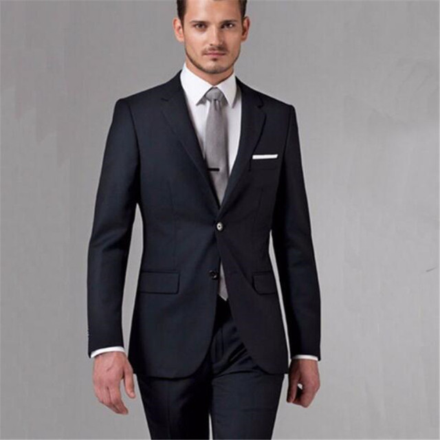 A British man with a tailored suit, a custom tailored black ...