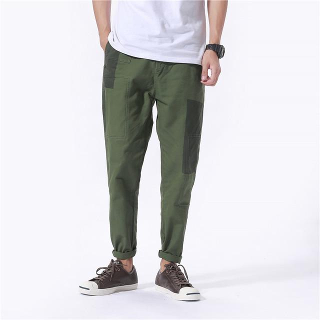 Calças ocasionais dos homens de moda de rua hiphop calças splice pano masculino marca solta calça mens basculadores sweatpants C154