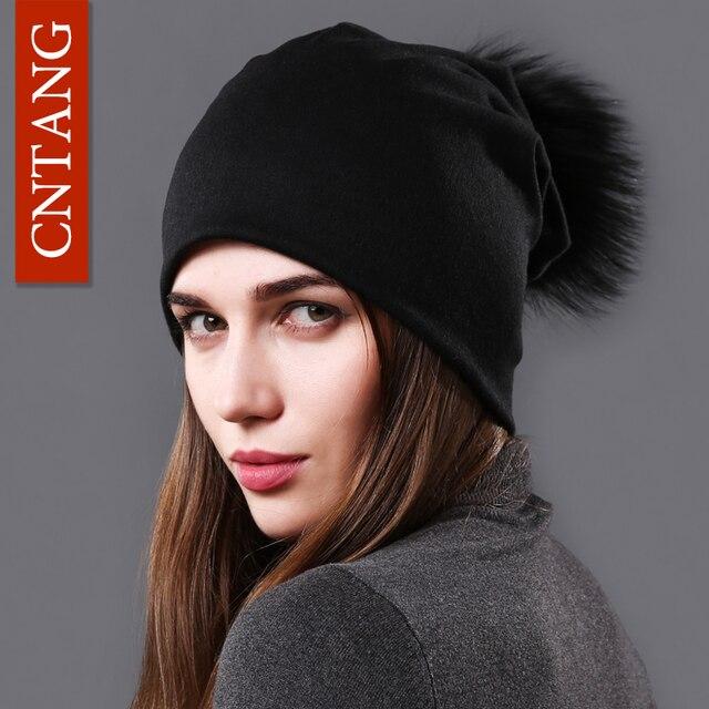 CNTANG mujer Natural de piel de mapache Pompom gorros Otoño Invierno  Caliente gorras para las mujeres 0b22da5af2e
