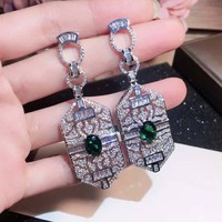 Hot selling luxury brand fashion sterling silver material earrings with Rhinestone hollow shield stud wedding jewelry
