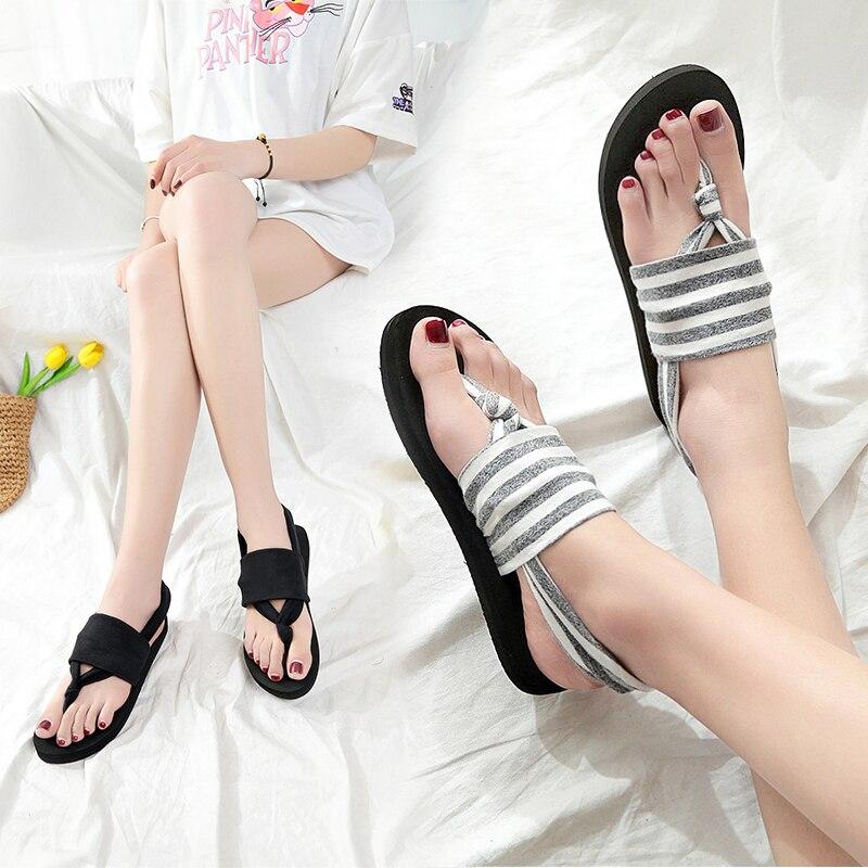 Sandals female summer 2018 flat Roman Bohemian word shoes new wild Korean fashion student shoes