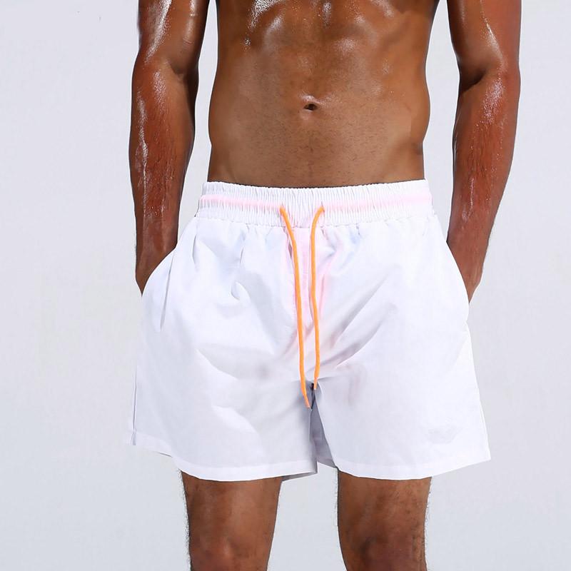 UMLIFE Swim Trunks Men Breathable Sport Swimming Shorts Solid Color Swim Briefs Elastic Waist Beach Shorts Summer Swim Shorts  (2)