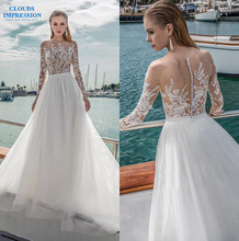 8e08bac99e CLOUDS IMPRESSION A-Line wedding dress 2019 romance bridal long sleeves  illusion bateau neckline heavily embellished bodice