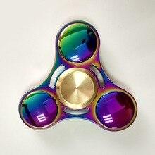 ใหม่ที่มีสีสันมือปั่นTri-s Pinnerอยู่ไม่สุขของเล่นแปรงชุบอลูมิเนียมEDCต่อต้านความเครียดของเล่น