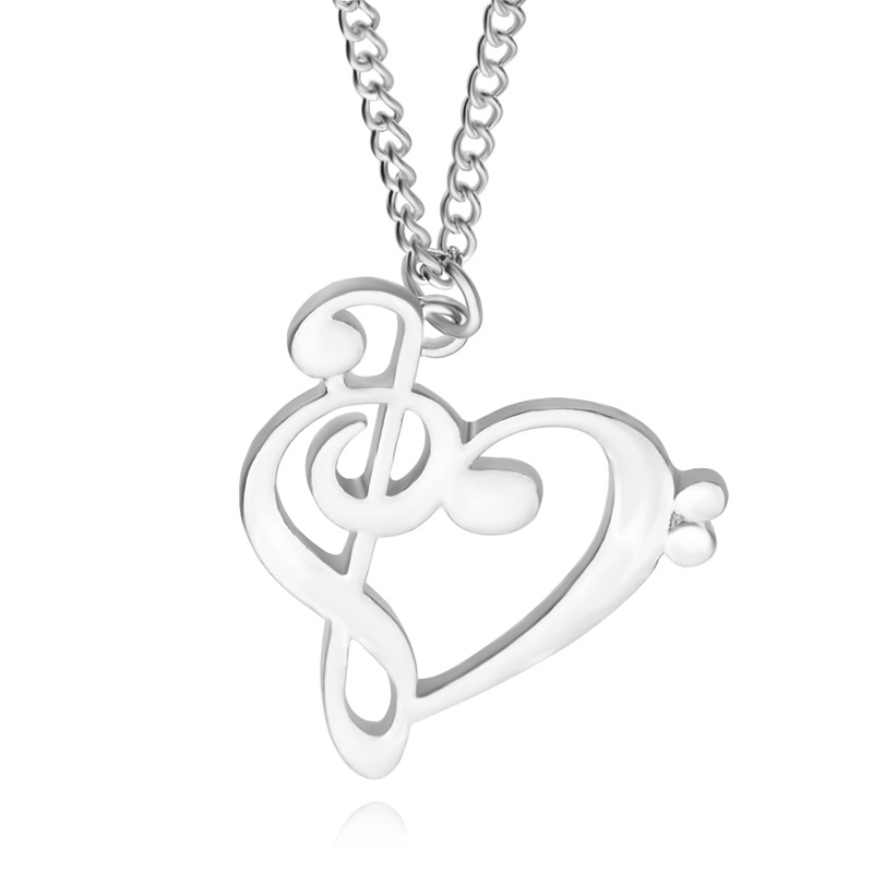 Hollow heart shaped musical note pendant necklace aloadofball Choice Image