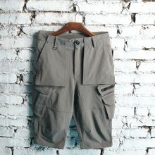 Youth Japanese and Korean version of the pure color summer straight pocket mens shorts tide large size fashion casual overalls