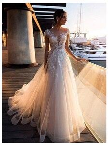 Image 1 - לורי Boho חתונה שמלת 2019 תחרה אפליקציות עם פרחי טול אונליין סקסי ללא משענת חוף הכלה שמלת חתונת שמלה