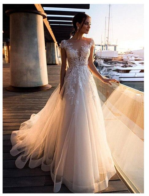 לורי Boho חתונה שמלת 2019 תחרה אפליקציות עם פרחי טול אונליין סקסי ללא משענת חוף הכלה שמלת חתונת שמלה