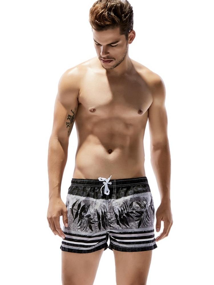 New Quick Dry Beach Shorts For Men Stylish Stripes Leaves Printed Fashion Summer Drawstring Sports Sunbath Surfing Board Shorts