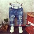 2016 Корейской версии новой детской одежды мальчиков Тонкий отверстие личности джинсы брюки ноги прилив
